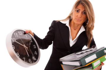 businesswoman holding a lot of folders and looking to time (isolated on white)